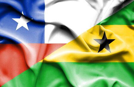 principe: Ondeando la bandera de Santo Tom� y Pr�ncipe y Chile Foto de archivo