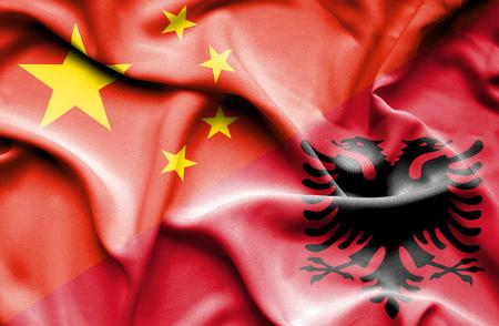 albania: Waving flag of Albania and Stock Photo