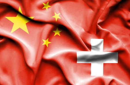 business relationship: Waving flag of Switzerland and Stock Photo