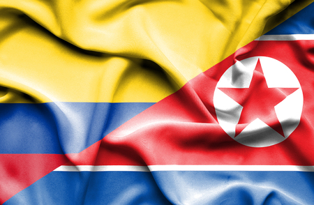 Waving flag of North Korea and Columbia