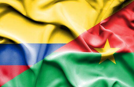 burkina faso: Waving flag of Burkina Faso and Columbia