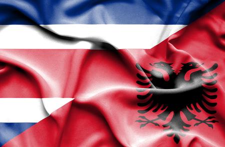 costa: Waving flag of Albania and Costa Rica Stock Photo