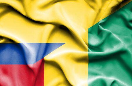 columbia: Waving flag of Guinea and Columbia Stock Photo