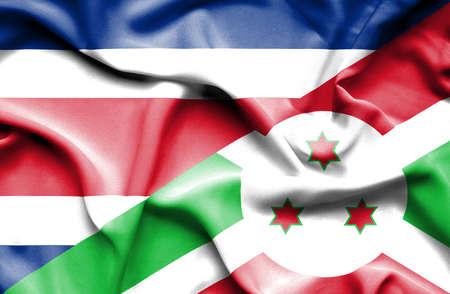 burundi: Waving flag of Burundi and Costa Rica Stock Photo