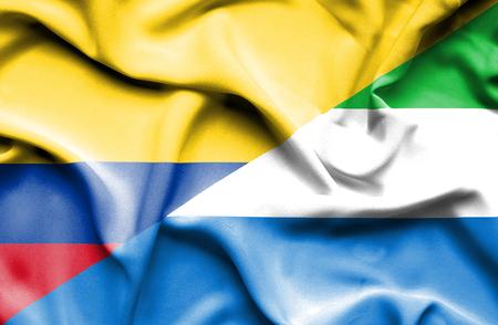 sierra leone: Waving flag of Sierra Leone and Columbia Stock Photo