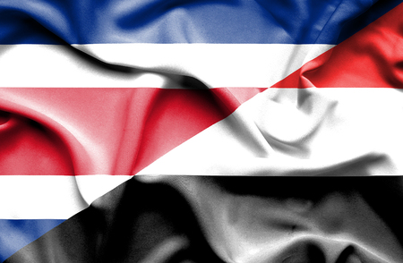 costa rica: Waving flag of Yemen and Costa Rica Stock Photo