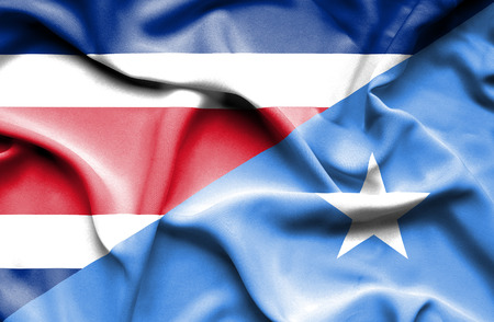 somalian culture: Waving flag of Somalia and Costa Rica Stock Photo