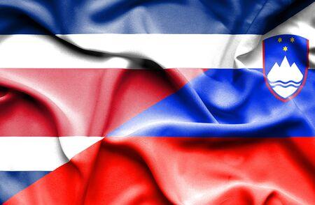 costa: Waving flag of Slovenia and Costa Rica Stock Photo