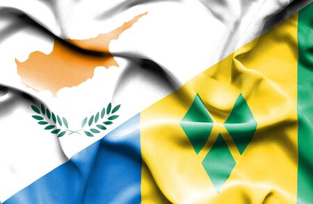 grenadines: Waving flag of Saint Vincent and Grenadines and Cyprus Stock Photo