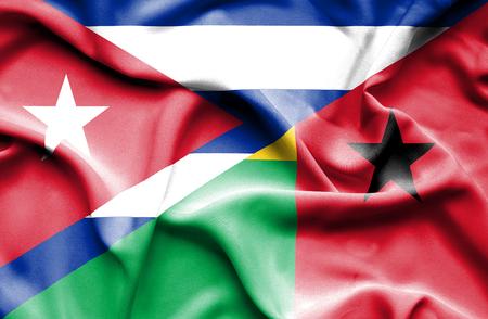 guinea bissau: Waving flag of Guinea Bissau and Cuba Stock Photo