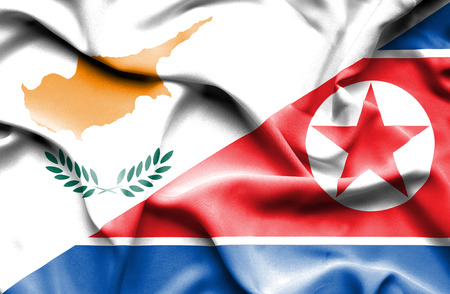 north korea: Waving flag of North Korea and Cyprus Stock Photo