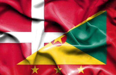 guernsey: Waving flag of Guernsey and Denmark Stock Photo