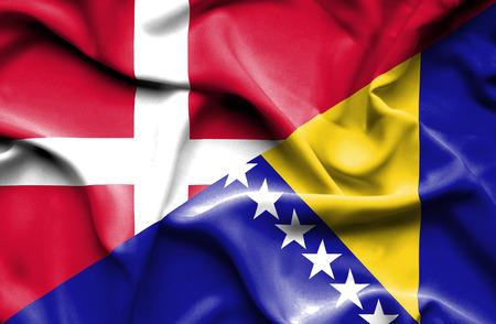 bosnian: Waving flag of Bosnia and Herzegovina and Denmark