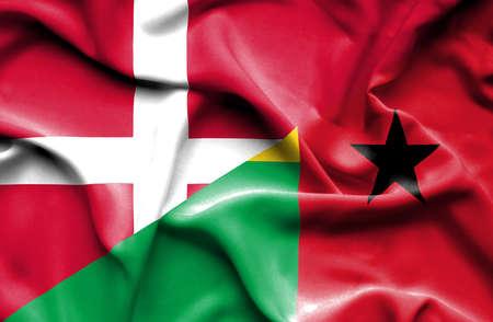 guinea bissau: Waving flag of Guinea Bissau and Denmark