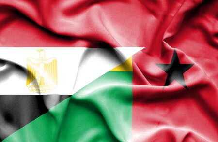 guinea bissau: Waving flag of Guinea Bissau and Egypt Stock Photo