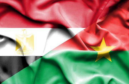 burkina faso: Waving flag of Burkina Faso and Egypt Stock Photo