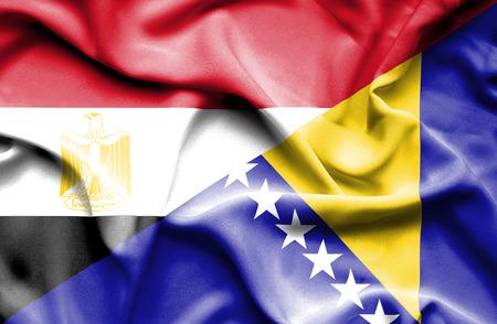 bosnian: Waving flag of Bosnia and Herzegovina and Egypt