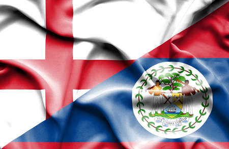 belize: Waving flag of Belize and England Stock Photo