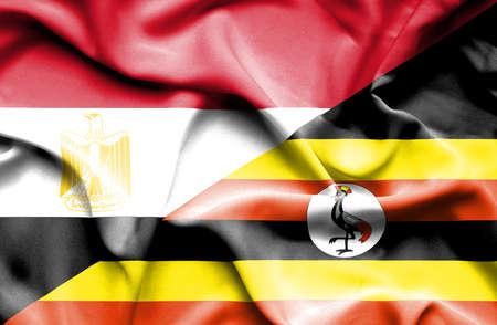 uganda: Waving flag of Uganda and Egypt
