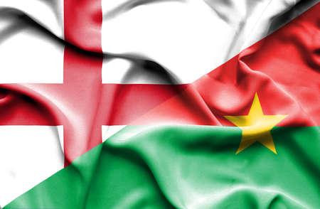 burkina faso: Waving flag of Burkina Faso and England Stock Photo