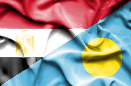 palau: Waving flag of Palau and Egypt Stock Photo