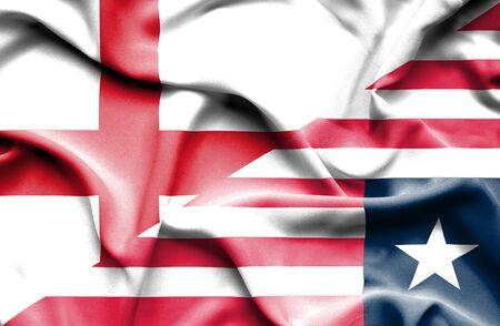 liberia: Waving flag of Liberia and England Stock Photo