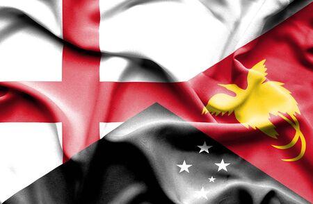 new england: Waving flag of Papua New Guinea and England