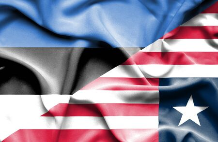 liberia: Waving flag of Liberia and Estonia