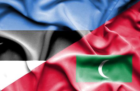 estonia: Waving flag of Maldives and Estonia Stock Photo