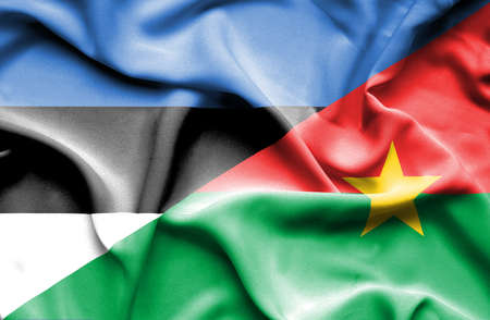burkina faso: Waving flag of Burkina Faso and Estonia