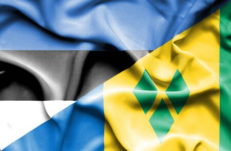 grenadines: Waving flag of Saint Vincent and Grenadines and Estonia