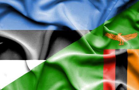 zimbabwe: Waving flag of Zimbabwe and Estonia Stock Photo