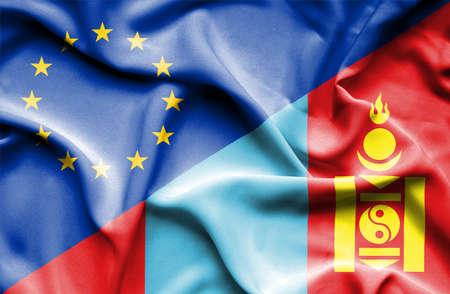 mongolia: Waving flag of Mongolia and Stock Photo