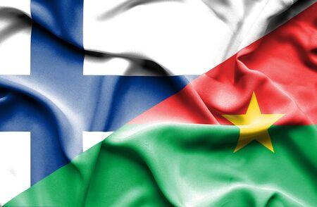 burkina faso: Waving flag of Burkina Faso and Finland
