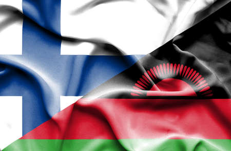 malawian: Waving flag of Malawi and Finland Stock Photo