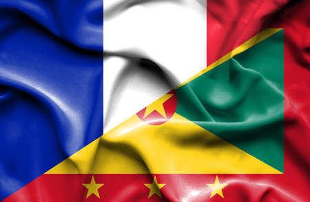 guernsey: Waving flag of Guernsey and France Stock Photo