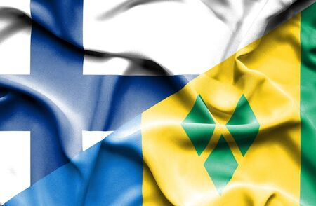 grenadines: Waving flag of Saint Vincent and Grenadines and Finland Stock Photo