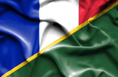 solomon: Waving flag of Solomon Islands and France Stock Photo