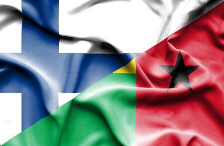 guinea bissau: Waving flag of Guinea Bissau and Finland