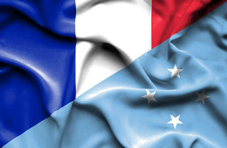 micronesia: Waving flag of Micronesia and France Stock Photo