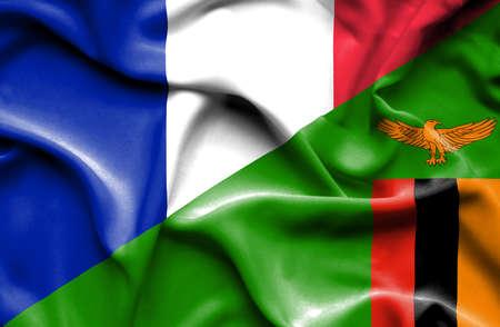 zimbabwe: Ondeando la bandera de Zimbabwe y Francia Foto de archivo
