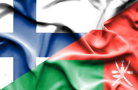 finland: Waving flag of Oman and Finland