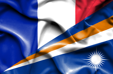 business competition: Waving flag of Marshall Islands and France