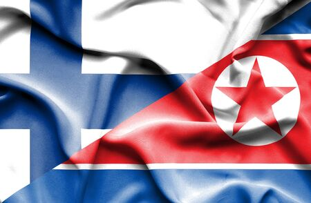 north korea: Waving flag of North Korea and Finland Stock Photo