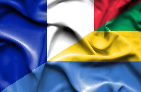 gabon: Waving flag of Gabon and France Stock Photo
