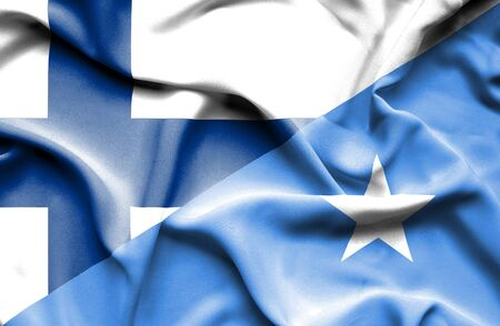 somalia: Waving flag of Somalia and Finland Stock Photo