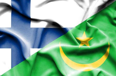 mauritania: Waving flag of Mauritania and Finland Stock Photo