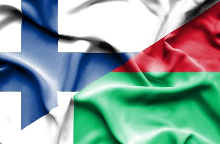 madagascar: Waving flag of Madagascar and Finland Stock Photo