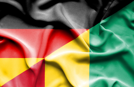 guinea: Waving flag of Guinea and