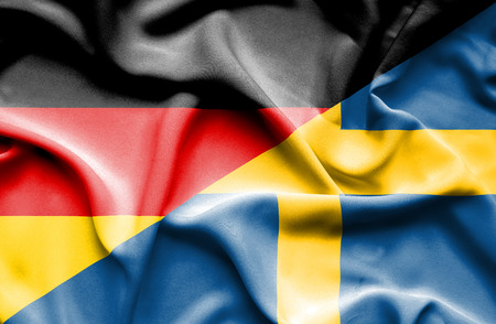 sweden: Waving flag of Sweden and Stock Photo